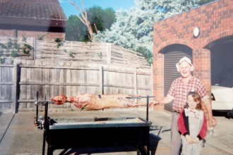 My papou and I cooking a lamb spit one Easter