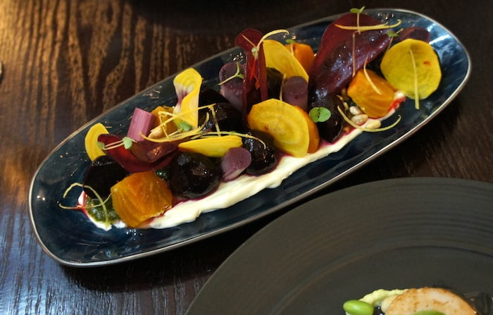 Salad of baby beetroots, basil pesto, goats curd, blueberry pickled heart of palm, crème fraiche