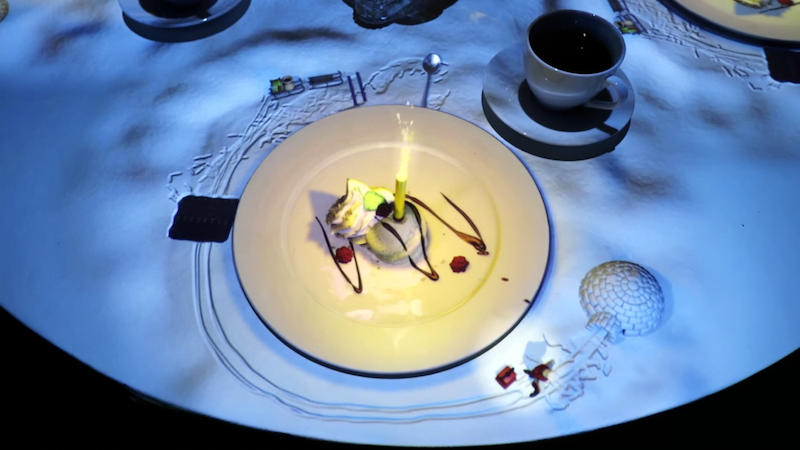 Miniature Chef projected onto table to create dessert