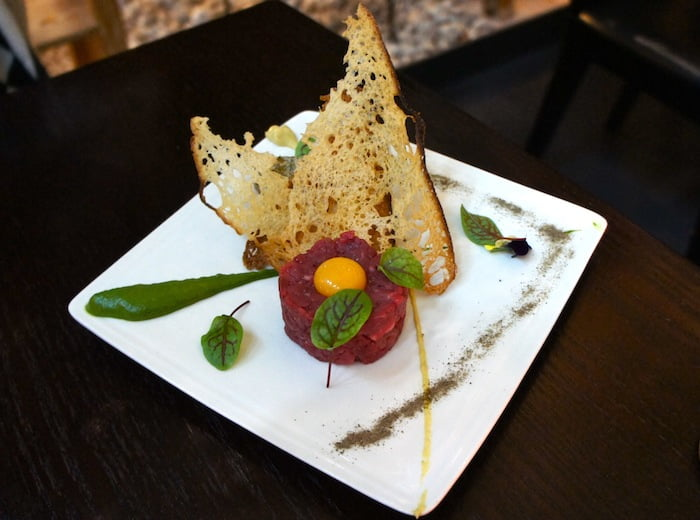 Steak tartare, caper powder, Dijon mustard, rocket puree, hazelnuts