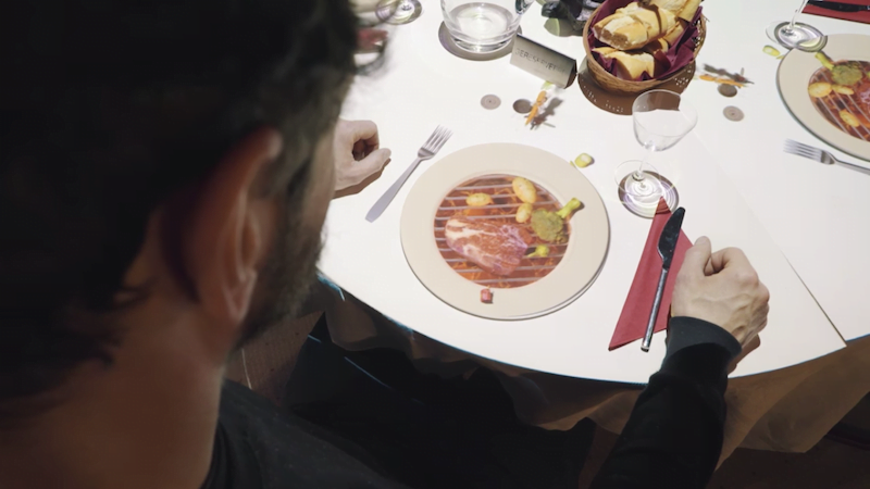 Man looking at projected miniature chef