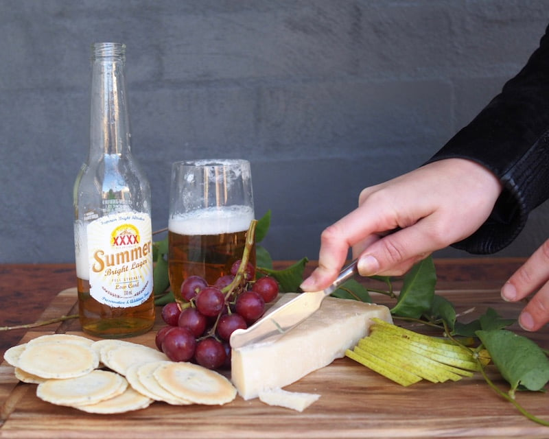 XXXX Summer Bright Ale Lager with asiago, colby or parmesan beer and cheese